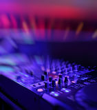 DJ mixer with light colored spotlights discos Royalty Free Stock Photo