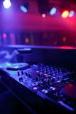 DJ mixer with light colored spotlights discos Royalty Free Stock Image