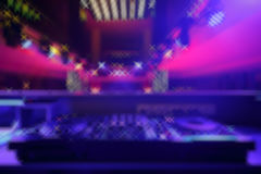 DJ mixer with light colored spotlights discos Royalty Free Stock Photography