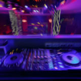 DJ mixer with light colored spotlights discos Stock Images