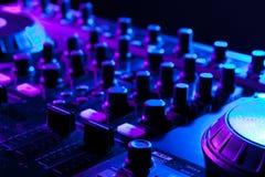 Dj mixer. In a night club. shallow DOF stock image