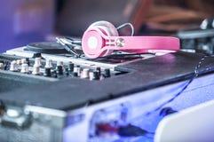 Dj mixer with pink headphones Royalty Free Stock Image