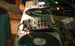 DJ mixer and record in a nightclub stock image
