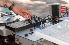 DJ mixes on equipment. Close-up Stock Images