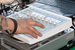 DJ mixes on equipment Stock Images