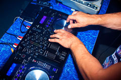 DJ mixes professional music equipment for disco in night club. DJ mixes professional music equipment for the disco in the night club Stock Photos