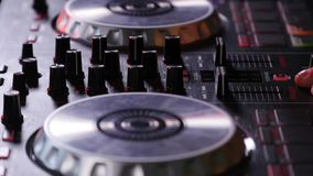 DJ mixes songs on equipment, hands closeup stock video footage