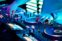 Dj mixes the track. In the nightclub at a party stock image