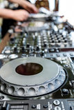 Dj mixes the track in club Royalty Free Stock Images