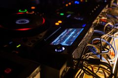 Dj mixes the track. In night club Royalty Free Stock Images