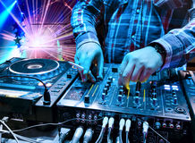 Dj mixes the track in the nightclub stock photography