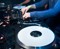 Dj mixes the track in the nightclub Royalty Free Stock Photography