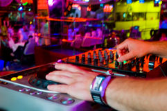 Dj mixes the track in the nightclub at a party Royalty Free Stock Photo