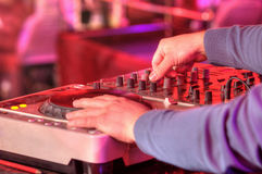 Dj mixes the track in the nightclub at a party Royalty Free Stock Image
