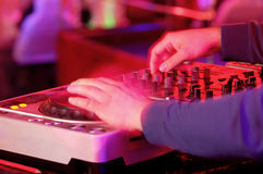 Dj mixes the track in the nightclub at a party Stock Image