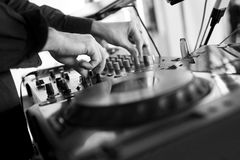 Dj mixes the track in the nightclub. At party Royalty Free Stock Photos