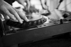 Dj mixes the track in the nightclub. At party Royalty Free Stock Images