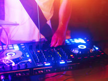 Dj mixes the track in the nightclub. At a party Royalty Free Stock Photo