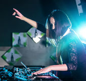 Dj mixes the track in the nightclub. Stock Images