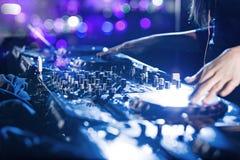 Dj mixes the track in the nightclub. Stock Photos