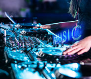 Dj mixes the track in the nightclub. Royalty Free Stock Photography