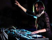 Dj mixes the track in the nightclub. Stock Image