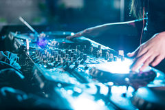 Dj mixes the track in the nightclub. Stock Photo