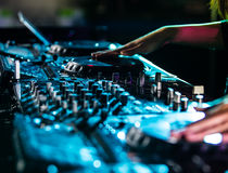 Dj mixes the track in the nightclub. Royalty Free Stock Photo