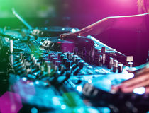 Dj mixes the track in the nightclub. Royalty Free Stock Photos