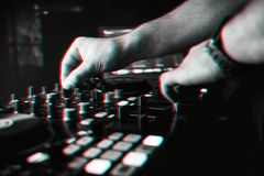 DJ mixes the track in nightclub at party hands royalty free stock images
