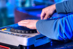 Dj mixes the track in the nightclub at a party Stock Photography