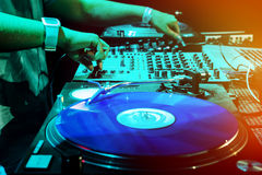 Dj mixes the track in the nightclub Royalty Free Stock Image