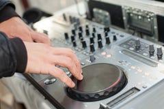Dj mixes track at party. Dj mixes the track at party Stock Image
