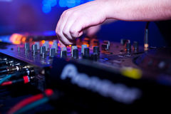 DJ mixing. In night club Royalty Free Stock Photography