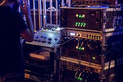 Dj mixing console and music audio amplifiers. On concert stock photo