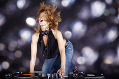 Dj with mixing console  woman Stock Photography