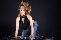 Dj with mixing console  woman Stock Image