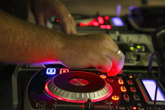 DJ Mixing. A DJ mixing on a console Royalty Free Stock Photography