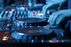 DJ mixing desk in nightclub