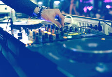 DJ mixing desk at party. With turntables and knobs Stock Images