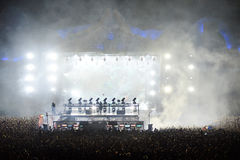 Dj mixing live on the stage at a music festival Stock Photography