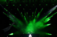 Dj mixing loive on the stage in front of crowd of people Royalty Free Stock Photo