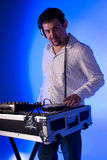 DJ mixing music. Royalty Free Stock Photos