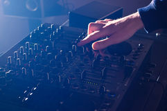 DJ mixing music on audio board mixer. DJ hand mixing music on audio board mixer Stock Photography