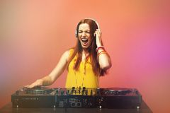 DJ mixing music on background. DJ mixing music on color background stock photo