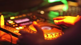 DJ mixing music. On console at the night club stock video