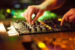 DJ mixing music on console at the night club Stock Photography