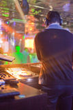 DJ mixing music on console at the night club Stock Images