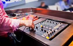 DJ mixing music on console at the night club Royalty Free Stock Images