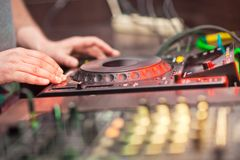 DJ mixing music on console Royalty Free Stock Photography